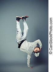 rapper man - Young man dancing hip-hop at studio.