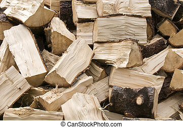 Firewood - Pile of chopped firewood for winter fuel