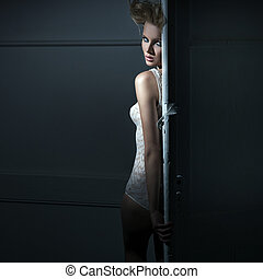 Young beauty behind the door