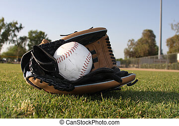 Softball in leather glove - Leather glove with batting...