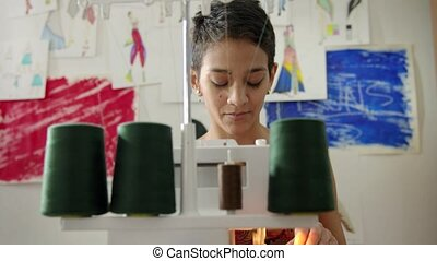 Young woman at work as tailor - Small business and...