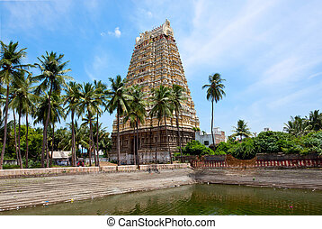 Gopura tower and temple tank of Lord Bhakthavatsaleswarar...