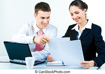 Paperwork - Portrait of two confident business partners...