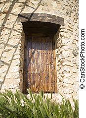 wood brown door of a mill at belmonte village spain