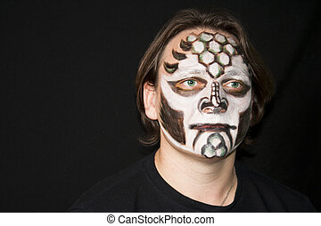 Make-up of a dragon on a man's face - Halloween. Make-up of...