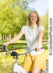 happy young woman on the bicycle