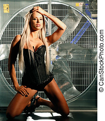 beautiful naked woman posing behind a huge wind fan - very...
