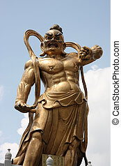 Chinese deity - Chinese temple statue of muscular warrior...