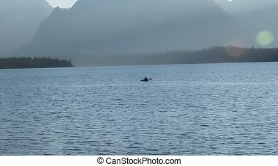 Kayaker in jackson lake Yellowstone