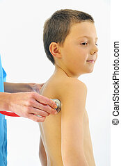 boy having health check with stethoscope in hospital