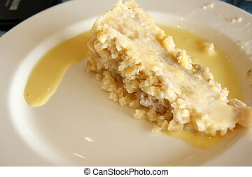 Apple crumble - Slice of apple crumble with custard on plate