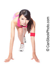woman athlete in position ready to run - Female athlete...