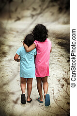 Walking Girls - Two young girls in blue and pink dresses...