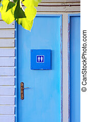 Unisex Toilet - Blue painted wooden door of a unisex...