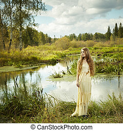 Photo of romantic woman in fairy forest. Beauty autumn