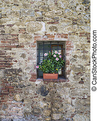 small window in a wall - Vertical image of an aging wall...