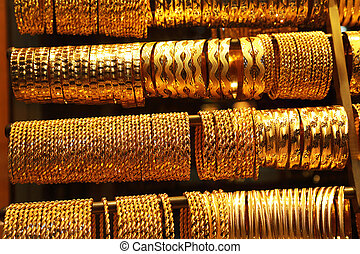 Gold Bangless in a market