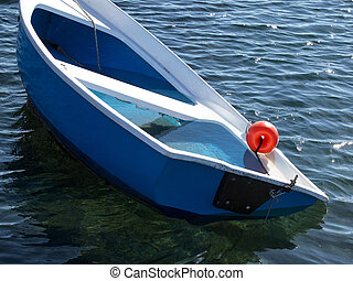 sinking boat - small plastic boat sinking after storm
