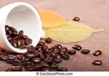 Coffe cup and leaves - White coffee cup, autumn leaves and...