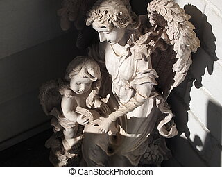 Angel and cherub - Angel looking over a cherub