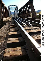 On the Trestle - On the rail of a railroad trestle over the...