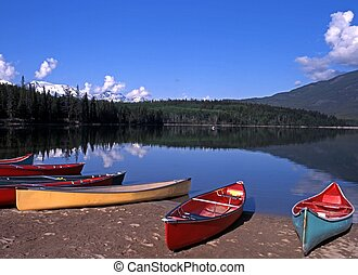 Pyramid Lake, Alberta, Canada - Canoes on the edge of...
