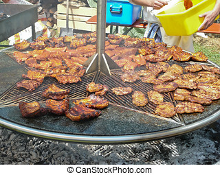 Spareribs on grill - Juicy mopped spareribs grilling on coal...