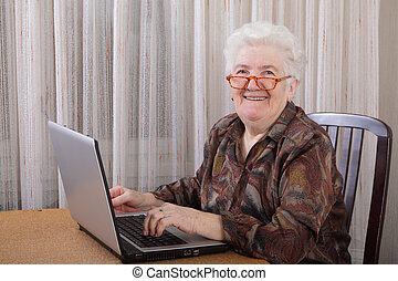 Old lady - Portrait of a senior woman working at computer