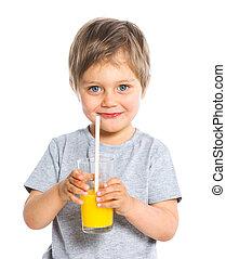 Portrait of little boy drinking orange juice - Portrait of...