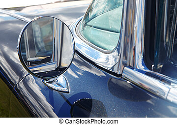 Rear-view mirror of retro car - Blue retro car Detail of...