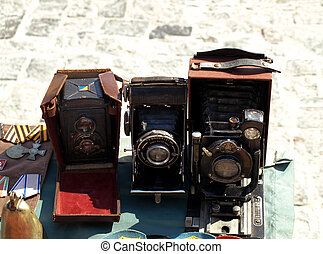 three antique camera and medals sold at the flea market