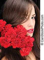 woman and red carnations - Pretty woman with hair over her...