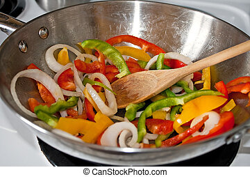 Stir Frying Vegetables in a Wok - Fresh sliced red green and...