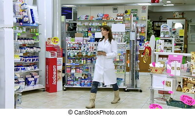 beautiful pharmacist working - Gorgeous young woman...