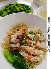 Egg chinese dry noodles with roast pork, dumpling and vegeta
