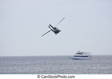 Helicopeters hovering over  ship