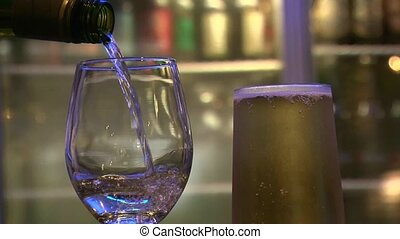 Wine being poured - WAIRAPA, NEW ZEALAND White wine being...