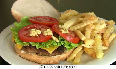 Cheeseburger and fries - Cheeseburger and French fries with...