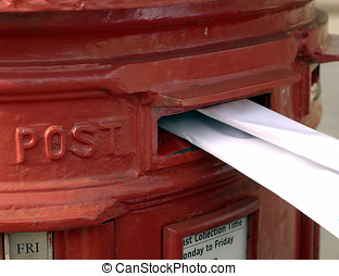 Folded letter posted - Letter being posted in a red British...