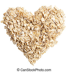 oat flakes heart shot from above - heap of oat flakes in a...
