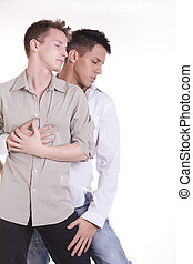 Passionate gay couple spooning