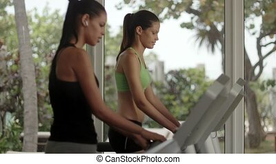 Young people exercising and running - Man and woman working...