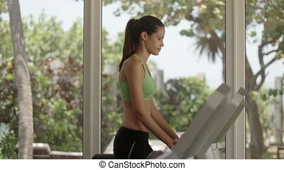 Young women working out, running
