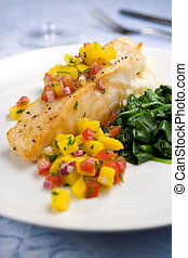 Sea bass with mango salsa - Pan-seared chilean sea bass with...
