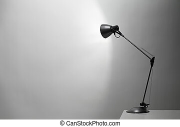 Desk Lamp - A Grey desk lamp pointed at a grey wall