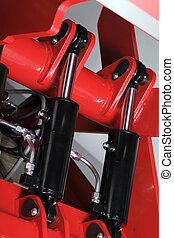 Hydraulic Cylinders - Industrial hydraulic cylinders on red...