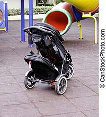 Baby carriage in playground