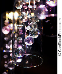 Abstract bright transparent glass balls on dark background -...