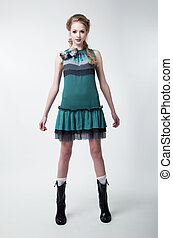 Lovely young fashion model female in modern dress