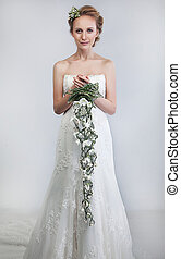 Lovely bride blond with bouquet of fresh tender flowers -...